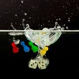 Vier Pions mit dem Spritzen des Wassers Lizenzfreies Stockfoto