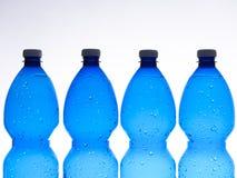 Vier plastic flessen Stock Afbeelding