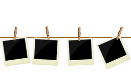 Vier polaroidabbildungen, die am Seil hängen Lizenzfreies Stockfoto