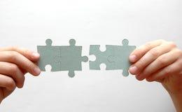 Vier Puzzlespielstücke Stockbild
