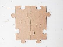 Vier Puzzlespielstücke Stockfotografie