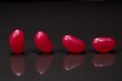 Vier rode jellybeans Stock Afbeelding