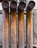 Vier roestige pijpen Stock Afbeelding