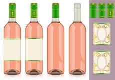 Vier rosè Weinflaschen mit Kennsatz Stockbilder