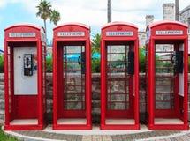 Vier rote Telefonzellen Stockbilder