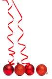 Vier rote Weihnachtsballdekorationen Stockbilder