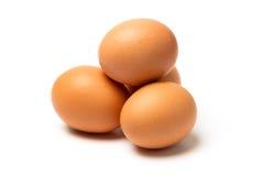 Vier eieren op witte achtergrond Stock Foto's
