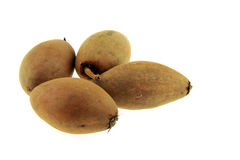 Vier sapodilla Thais fruit Stock Afbeeldingen