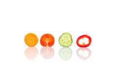 Vier scherpe die stukken van groente op wit worden geïsoleerd Royalty-vrije Stock Afbeelding