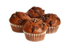 Vier Schokoladenmuffins lizenzfreie stockbilder