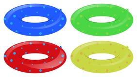 Vier Schwimmenringe in den verschiedenen Farben Stockfoto