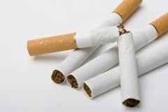 Vier sigaretten Stock Foto's