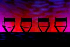 Vier silhouet van de Stoelen van de Directeur op het Stadium van de Werveling Stock Fotografie