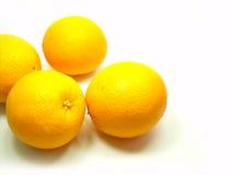 Vier sinaasappelen op Achtergrond Royalty-vrije Stock Foto