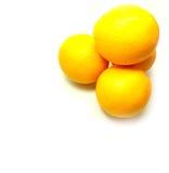 Vier sinaasappelen op Achtergrond Royalty-vrije Stock Foto's