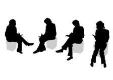 Vier sitzende Mädchen Stockfoto