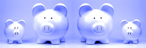 Vier Spaarvarkens royalty-vrije stock afbeelding