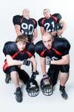 Vier Spieler des amerikanischen Fußballs Lizenzfreie Stockfotografie