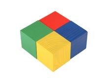 Vier Spielzeugwürfel Stockfotografie