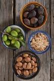 Vier Stadien von Arganfrüchten Stockbilder
