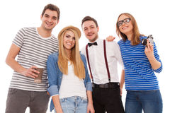 Vier stilvolle junge Leute auf weißem Hintergrund Stockfoto