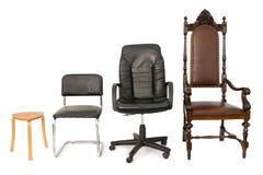 Vier stoelen die ontwikkeling, carrière vertegenwoordigen Stock Foto's