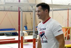 Vier-tijd Olympische kampioen Alexei Nemov in de sporten complexe ` Olympische ` stock afbeelding