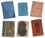 Vier uitstekende oude boeken die op witte achtergrond worden ge?soleerd Oude bibliotheek stock foto's