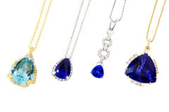 Vier unterschiedlicher Designer Pendants mit Tanzanite, Aquamarin und Diamanten stockfotografie