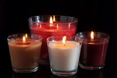 Vier van het branden van kaarsen in de houders van de glaskaars Royalty-vrije Stock Afbeeldingen