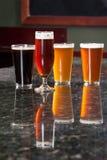 Vier verschillende bieren stock foto's