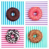 Vier verschillende donuts op gestreepte multicolored strepen hoogste mening als achtergrond royalty-vrije stock afbeeldingen