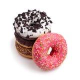 Vier verschillende donuts op witte hoogste mening als achtergrond stock afbeelding