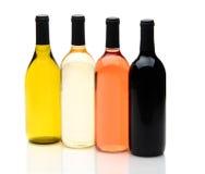 Vier Verschillende Flessen van de Wijn op Wit Royalty-vrije Stock Fotografie