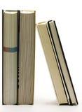 Vier vertikale Bücher auf Weiß stockbilder
