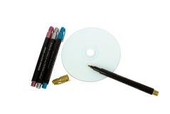 Vier voelden pennen dichtbij CD stock foto's