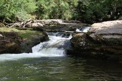Vier Watervallengang in Brecon-Bakens Stock Foto's