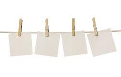 Vier weiße unbelegte Anmerkungen Lizenzfreie Stockbilder