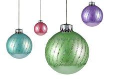 Vier Weihnachtsbaumverzierungen Stockfotografie