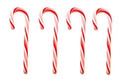 Vier Weihnachtszuckerstangen getrennt auf Weiß Stockbild