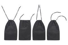 vier zwarte die zakken op wit worden geïsoleerd Stock Foto