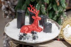 Vier zwarte kaarsen op de plaat Royalty-vrije Stock Afbeeldingen