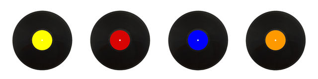 Vier zwarte LP-verslagen in kleurenetiketten Stock Foto