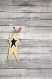 Vierde van juli-ster op houten vloer Stock Foto