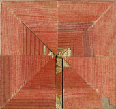 Vierflächige quadratische dekorative Rosette von hölzernen Gestaltungsstreifen Lizenzfreies Stockbild