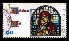 Vierge bénie en verre souillé avec l'enfant photo stock