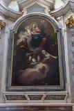 Vierge et enfant adorés par le St Francis d'Assisi, de Clare et d'Anthony de Padoue photographie stock