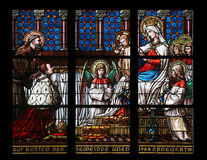 Vierge Marie avec le bébé Jésus, les anges et les saints Photographie stock libre de droits