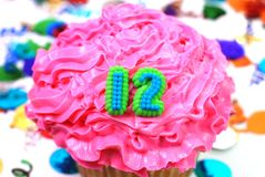 Viering Cupcake - Nummer 12 Stock Foto