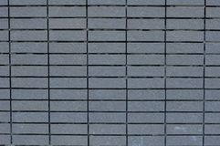 Vierkante bakstenen muur in Asgrauwe kleur Royalty-vrije Stock Foto